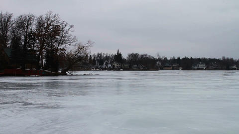 1123 Frozen Lake During Winter Next to Houses Stock Video Footage