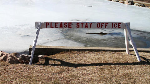 1130 Thin Ice on Pond, Stay Off Ice Stock Video Footage