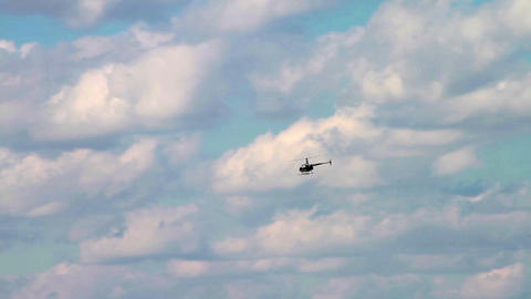 1182 Helicopter Flying with Blue Sky and Clouds Stock Video Footage