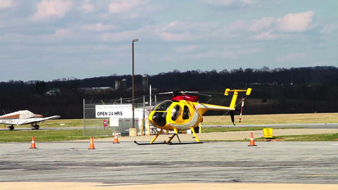 1186 Yellow Helicopter at Airport Footage