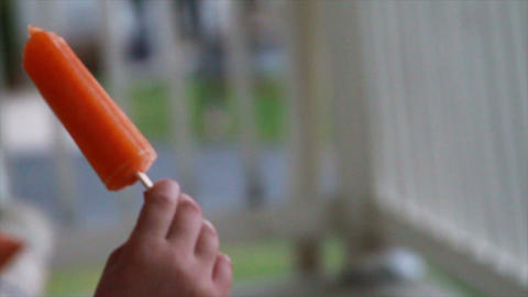 1212 Child Eating a Popsicle , Orange Footage