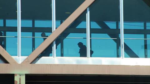0953 Commuters Walking on Bridge after Work Footage