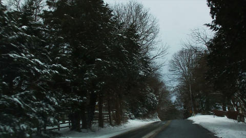 0719 Driving in Snow through the Trees, Slow Motio Footage