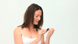 Beauty woman filing her nails Footage