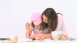 Cute mom baking with her daughter Footage