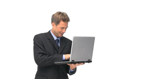 A joyful businessman with his laptop Footage