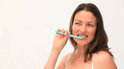 Woman brushing her teeth Stock Video Footage