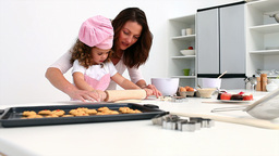 A little girl baking with her mother Footage