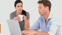 A couple talking around their laptop Footage