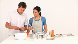 Lovely couple cooking together Stock Video Footage