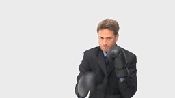 Businessman boxing towards the camera Stock Video Footage