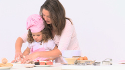 Joyful women baking with her young daughter Footage