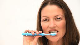 Cute women brushing her teeth Stock Video Footage