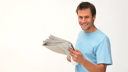Smiling man reading a newspaper Footage