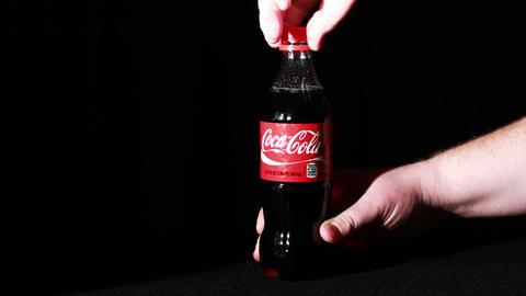 0613 Coke Bottle Being Open Up Footage