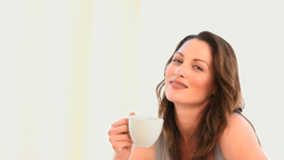 A wonderful woman smiling with a cup of coffee Stock Video Footage