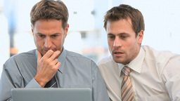 Businessmen looking at their laptop Stock Video Footage
