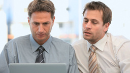 Businessmen looking at their laptop Footage