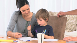 Adorable Mother Helping Her Son To Drawing stock footage