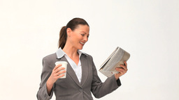 Businesswoman reading a newspaper Footage
