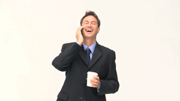 Businessman talking on the phone during a coffee b Footage