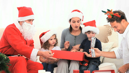 Family opening gift with Santa Claus Stock Video Footage