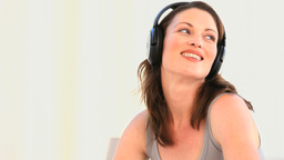 Beautiful woman listening to music Stock Video Footage