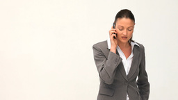 Serious businesswoman talking on the phone Stock Video Footage