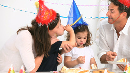 Family having fun during a birthday party Footage
