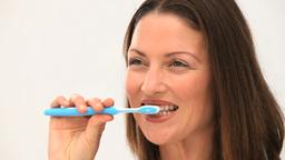 Woman brushing his teeth Stock Video Footage
