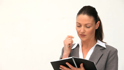 Businesswoman writing in her agenda Stock Video Footage