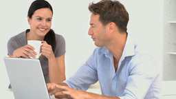 Man talking with her girlfriend while he is workin Stock Video Footage