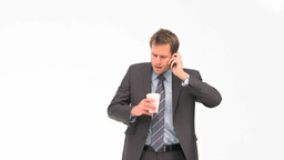 Businessman phoning while drinking coffee Stock Video Footage