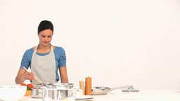 Woman preparing sauce for lunch Stock Video Footage