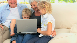 Family laughing in front of a computer Stock Video Footage