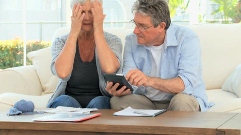 Mature couple calculating their domestic bills Footage