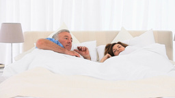 Mature couple waking up Stock Video Footage