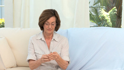 Mature woman taking medicine Footage