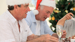Elderly friends playing during christmas Stock Video Footage