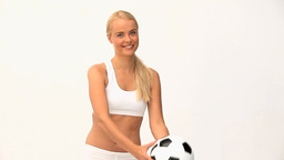 Blond woman playing with a ball Stock Video Footage