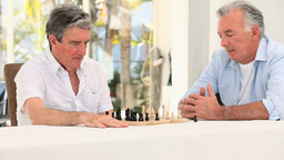 Senior friends men playing chess Stock Video Footage