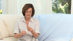 Retired woman taking medicine Stock Video Footage