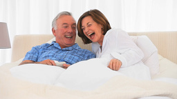 Retired couple watching tv Stock Video Footage