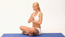 Pretty blond woman doing yoga Footage