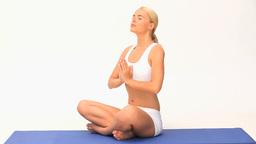 Pretty woman doing yoga Stock Video Footage