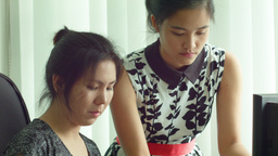 Asian Office Workers Working Together in an Office Stock Video Footage