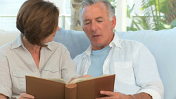 Mature couple looking at a photo album Footage