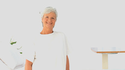 Mature woman looking at the camera Stock Video Footage