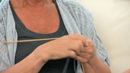 Senior woman knitting very fast Footage