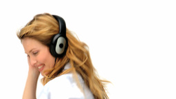 Cute blonde lady dancing with headphones Stock Video Footage